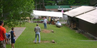 Having fun with horseshoes. ping pong Flaming Arrow Campground Smoky Mountains Cherokee camping