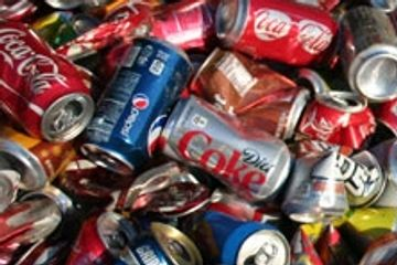 mixed picture of copper, aluminum cans, flattened aluminum