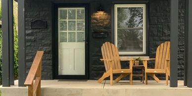 Duplex black exterior and front porch patio chairs