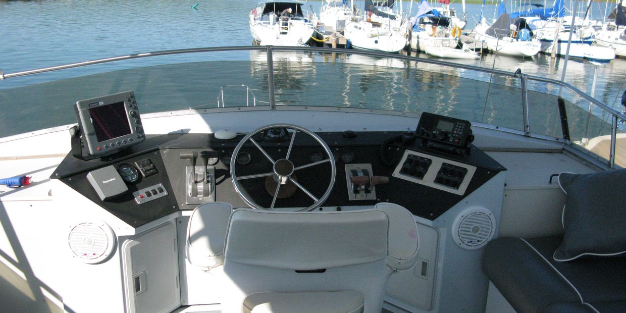 Imagine yourself on the fly bridge of this boat , sitting at the helm in your own captain's chair