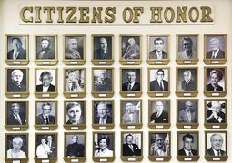"Photos of ""Citizens of Honor"" on display in the Pearce Building."