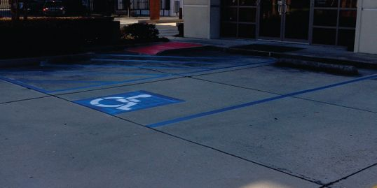 Accessibility parking spot pavement markings