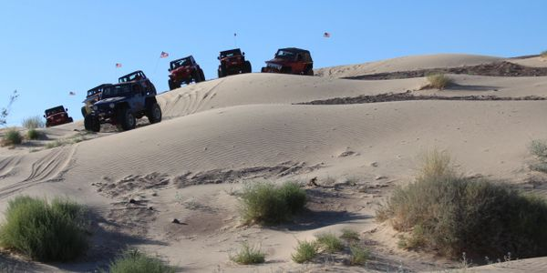 Several Jeeps on a tour at Nellis Sand Dunes.