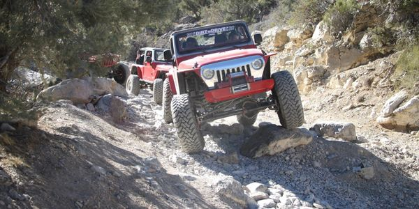 Jeeps climbing over large rocks at Red Rock Canyon