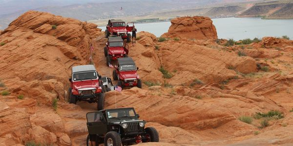 Several Jeeps over looking Sand Hollow State Park on a off road Tour.