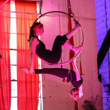 Family aerial mom & child do a man in the moon and arch pose in their aerial hoop class