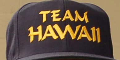 Navy colored ball cap with Team Hawaii logo embroidered in golden yellow thread