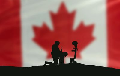 Soldier kneeling in front of Canadian Flag, whalley whalley legion whalley 229 229 legion