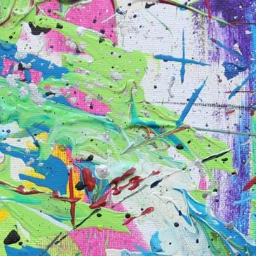 Abstract painting with flecks of green, blue, pink, yellow and white