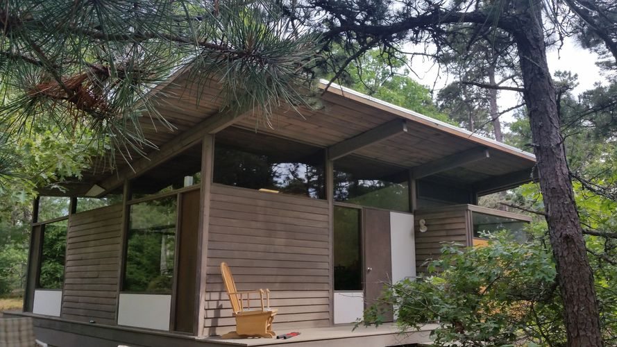 Hidden Village is five  original mid-century modern summer houses, situated on 16 acres of private p