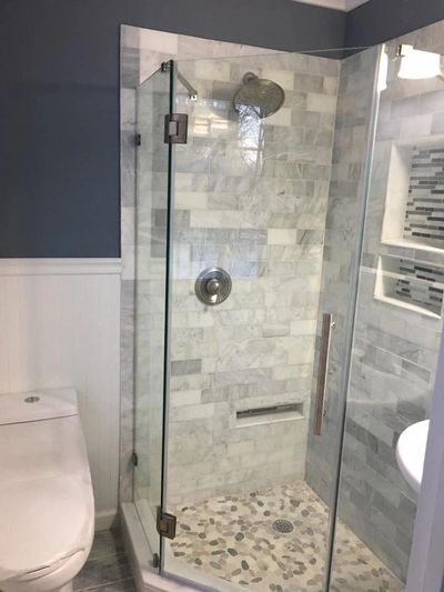 Custom Shower stall ,home made shower pan ,frameless glass enclosure with marble subway tiles