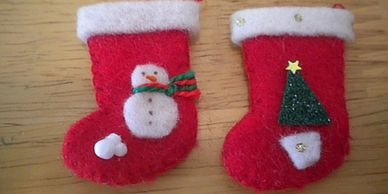 Handmade Miniature Christmas Stockings in 4 different holiday designs. Snowman, Tree, Holly & Beads.