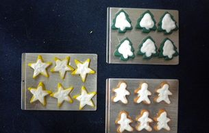 "Christmas cookie sheets. Chose from stars, trees and gingerbread. ""Baking Cookie"" sets available."