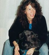Author E. Merwin with black lab Amy