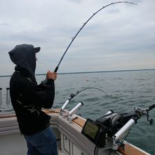 "A client aboard the Yankee Troller hooked up with a Lake Ontario Chinook ""King"" Salmon"