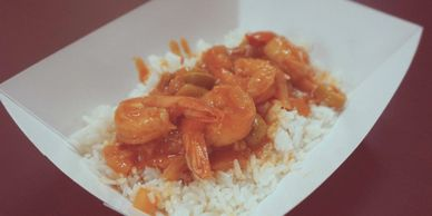 Pink shrimp on a bed of white rice.