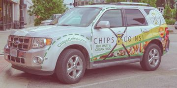A photograph of the Chips & Coins delivery vehicle.