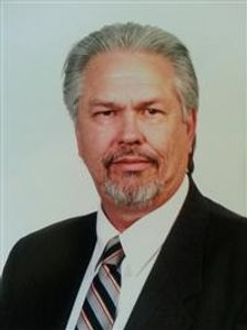 An older man in a business suit.