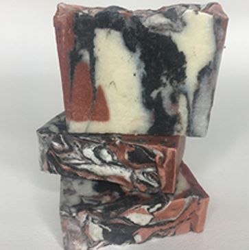 handmade facial soap with rose clay, activated charcoal and tee tree essential oil