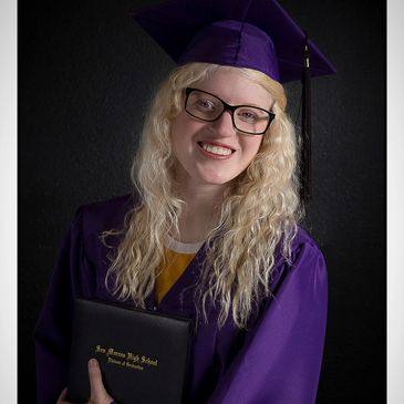 Portrait of a San Marcos High School student in Cap and Gown.