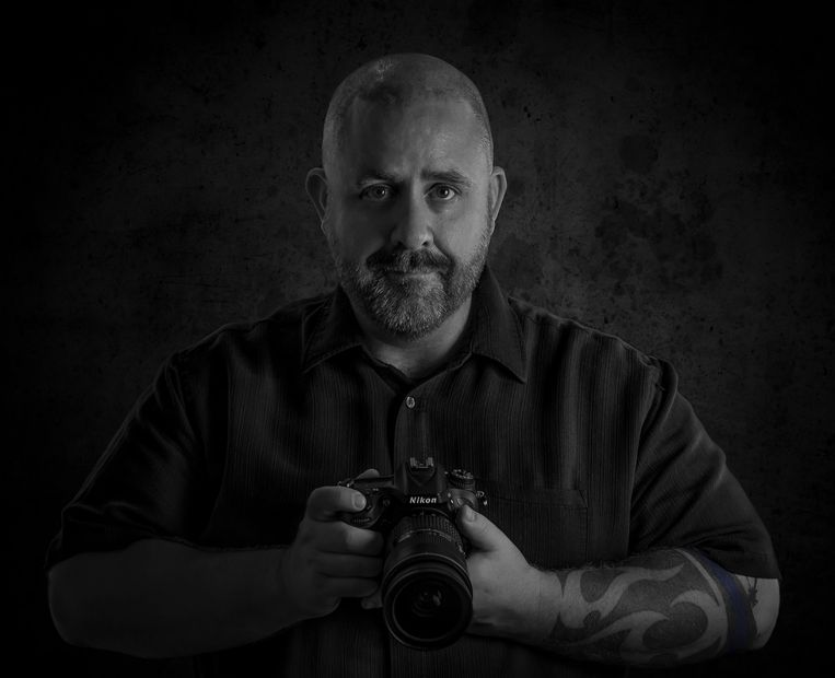 San Marcos professional photographer Greg Mitchum in a black and white portrait.