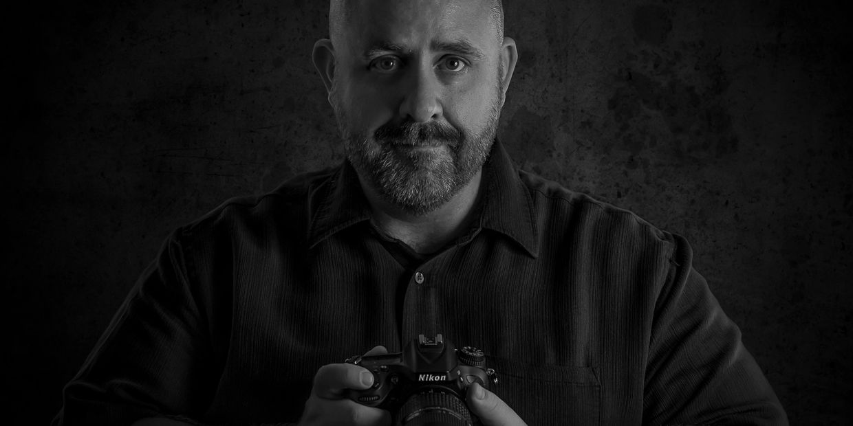 Black and White image of a portrait of certified professional photographer, Greg Mitchum.