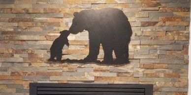 Mama bear and cub metal wildlife wall art mounted above fireplace mantle from Back 40 Metal Worx.