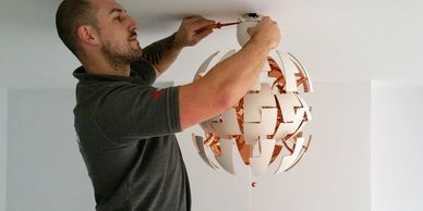 Replace a light fitting. electrician in carshalton, coulsdon, croydon and wallington. swap a light.