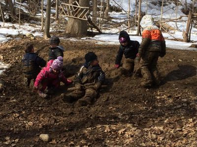 kids playing in the mud. Nature-based preschool, forest preschool, outdoor education, nature play, child-led curriculum, nature-based preschool consulting, outdoor classroom