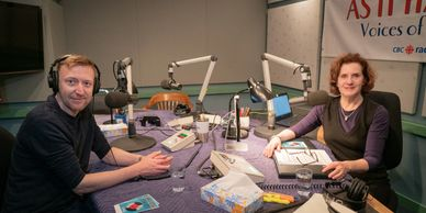 Chris Flanagan and Carol Off speak in CBC radio studio