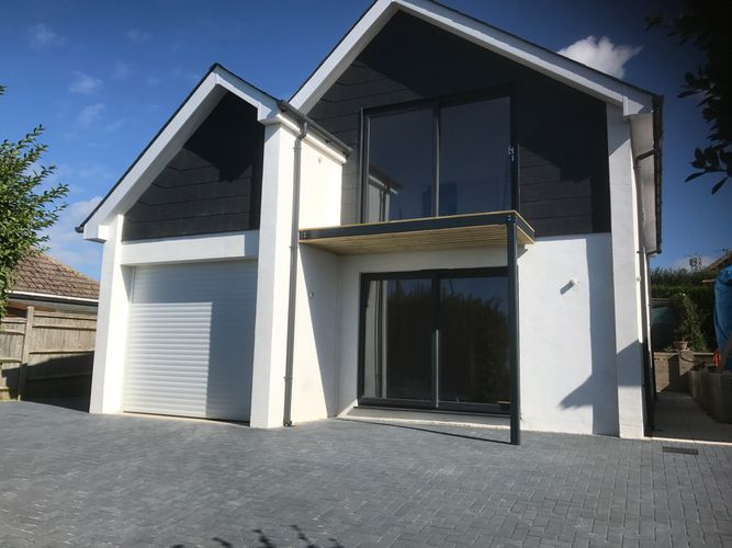 New build house sips panel timber frame, render finish, anthracite grey doors and window, slate roof