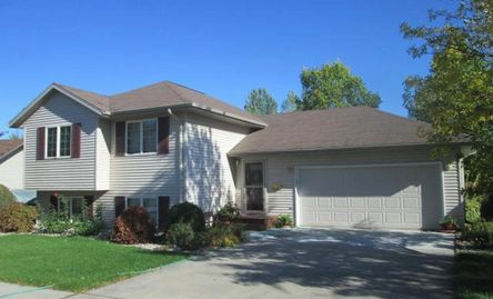Neat one owner 4 bedroom, 2 bath on  large landscaped lot. About a mile west of UND. Only $229,900!