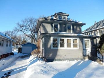 100 Yerar old classic in south end of Grand Forks, ND with lots of original woodwork