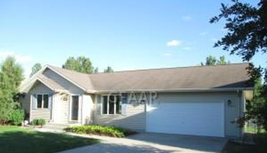 Very nice three bedroom, two bath ranch only a mile west of the University of ND. Huge lot with chai