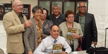 "Author Dave Gutierrez with the family of Company E Veteran Guillermo ""Willie"" De Leon"