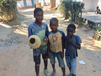 Three young boys on the streets of LaVictoire.