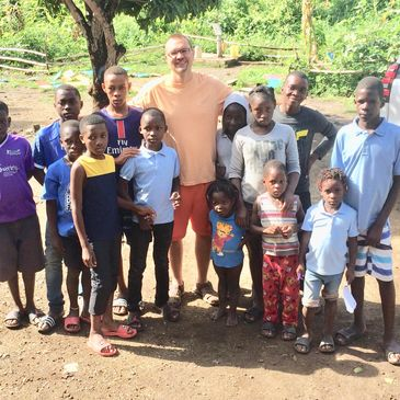 Troy is pictured here with the children  from the Orphanage.