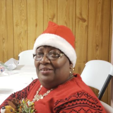 Sister Retha Gause was in the Christmas Spirit with her Santa hat and her Christmas Sweater.