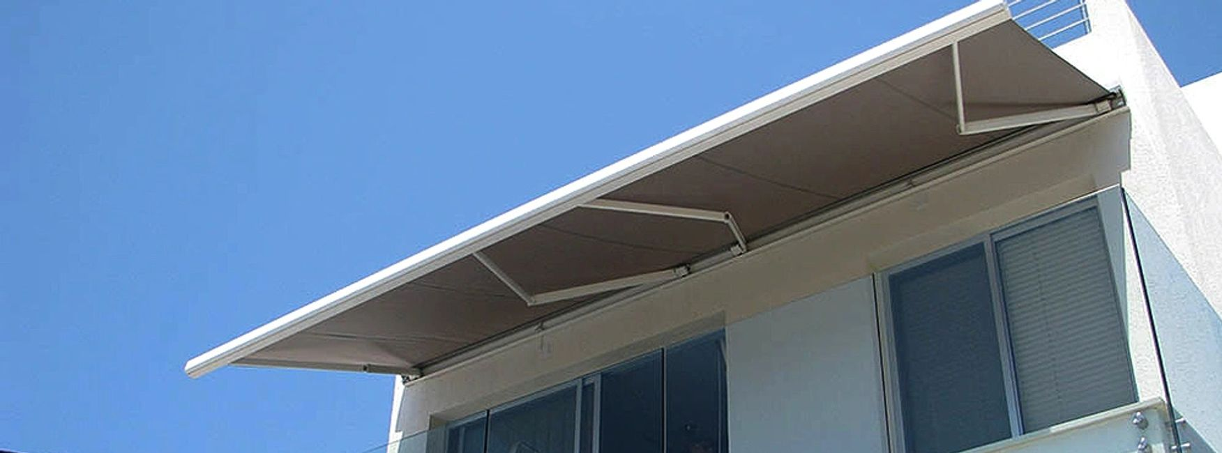 Retractable awnings for sun shade in Cyprus, by Shadeports Plus.