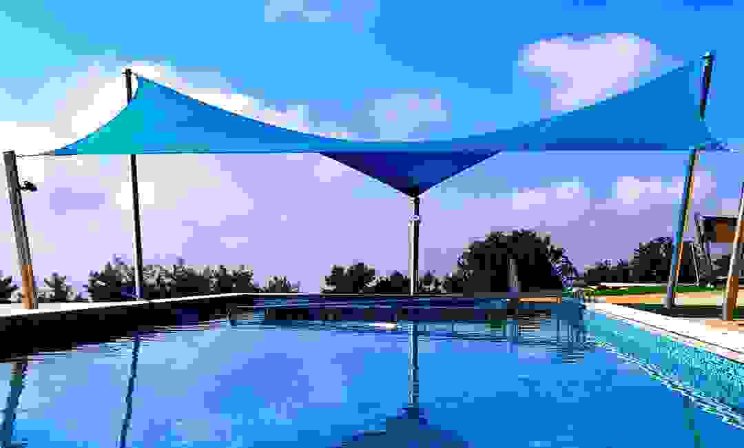 Custom shade sail over a swimming pool in Peyia, Paphos, Cyprus.