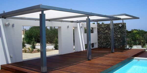 Flat pergola cover providing patio shade by Shadeports Plus Cyprus.