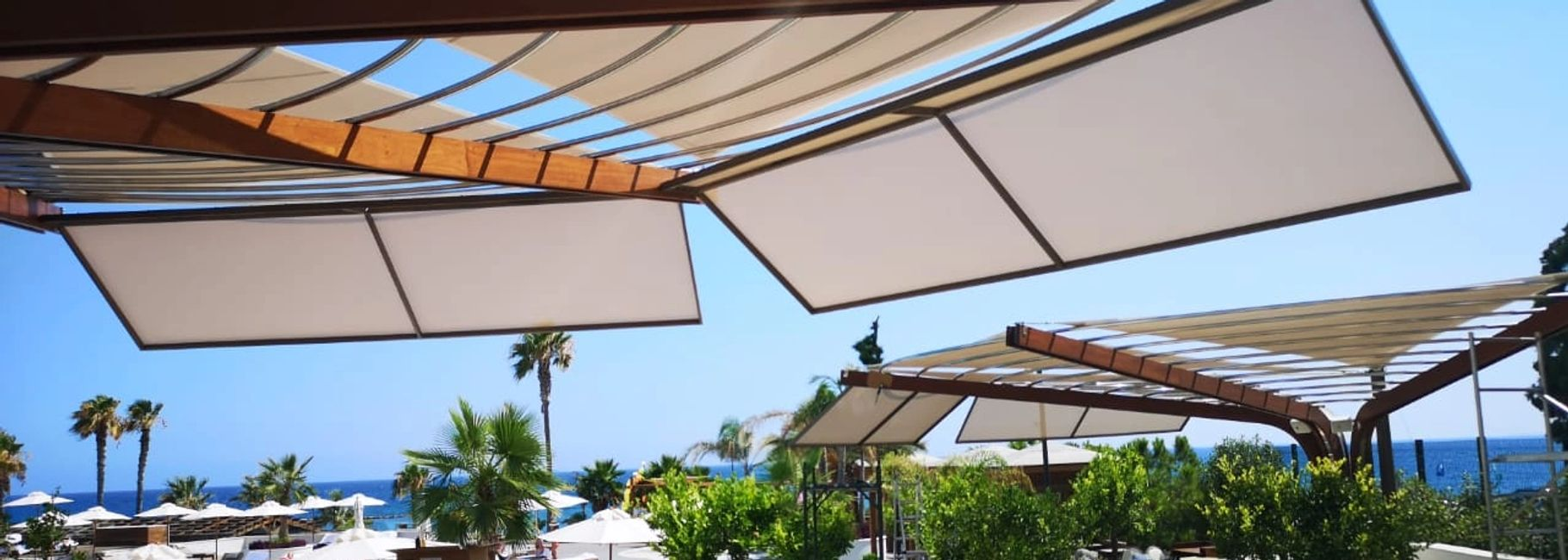 Shade sails covering a canopy construction, by Shadeports Plus Ltd., Cyprus.