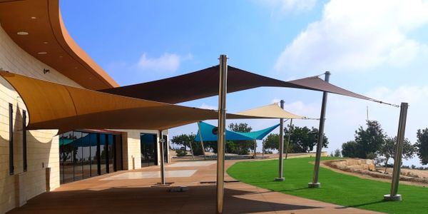 Two outdoor shade sails providing sun shade and patio shade by Shadeports Plus Cyprus.
