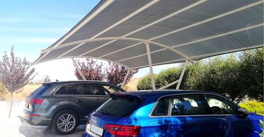 a carport providing car shade by Shadeports Plus Cyprus.