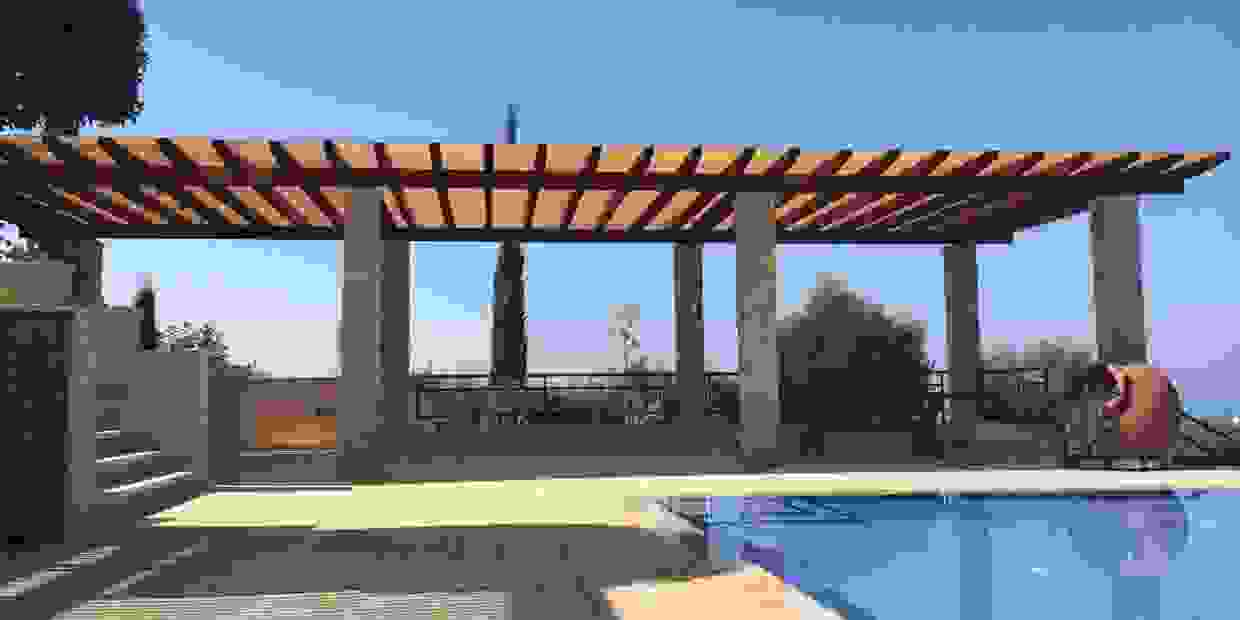 Custom-made pergola with shade canopy cover using shade cloth by Shadeports Plus, Cyprus.