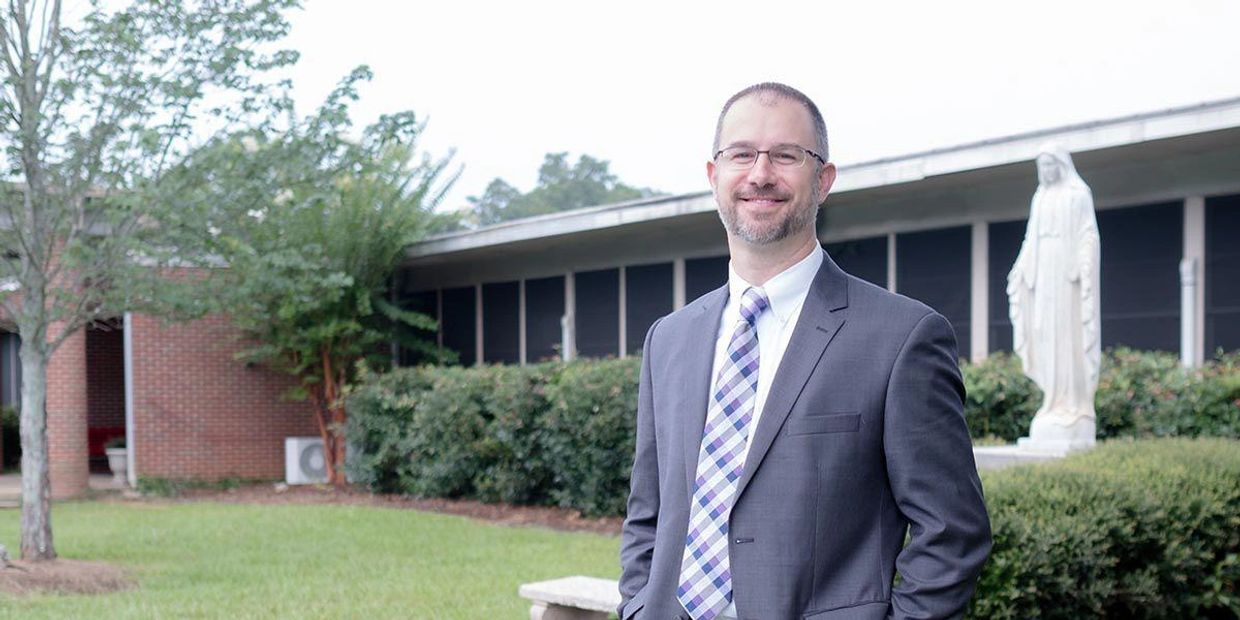 Dr. Jeremiah Russell, Sacred Heart Principal