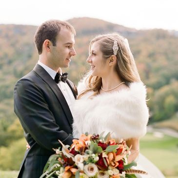 Old Edwards Inn Wedding Mountains Fall lush ceremony. Bride and Groom. Bouquet. Orchids. Feathers.