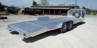 solid aluminum car hauler trailer with spare tire mounted behind the road guard