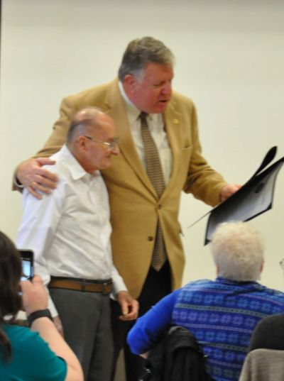 "Maryland State Senator ""Big"" Ed Reilly presents a citation to Bruce Michalec at his retirement party"