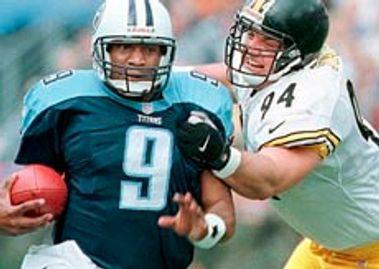 Steve McNair (9) and Jeremy Staat (94)